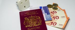 euro pass reseadapter panorama 300x120 - Uk Passport European Insurance Card And Euros With Travel Plug Adapter And Euro Currency